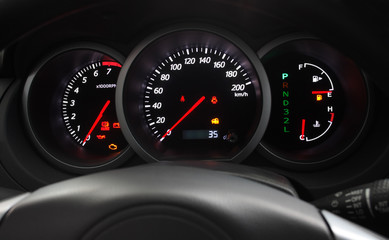 Car Dashboard closeup with glowing arrows