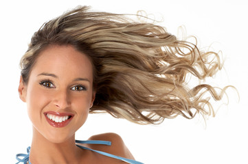 Pretty girl with great fly-away hair. Over white background.