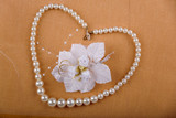Pearl heart with flower and wedding rings poster