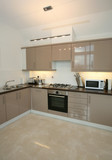 Interior of modern kitchen with integrated appliances poster