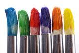 Fototapeta The tips of three colorful paintbrushes ready to be used.