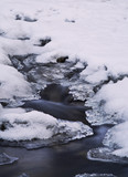 Long exposure image of a cold brook in winter. poster