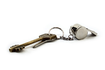 door keys and whistle as trinket on white