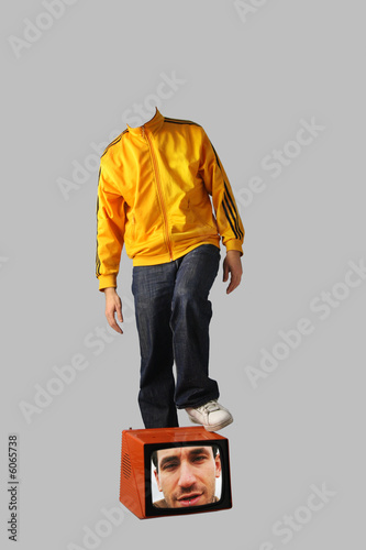 headless man with foot on tv with head in it