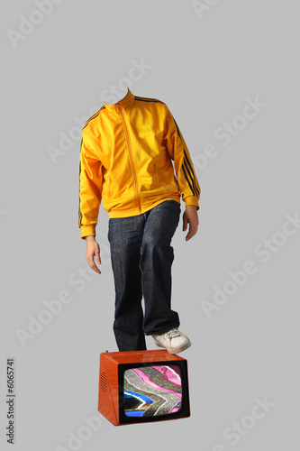 headless man with foot on tv