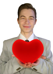 The young man with a red heart in hands