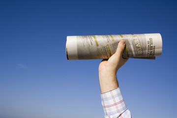 a hand with a newspaper, sending the news