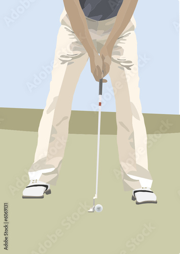 Golfer preparing to hit ball with club