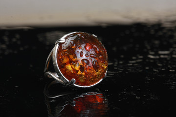 silver ring with amber stone cabochon