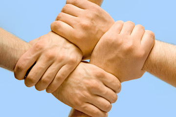 Image of crossed hands isolated over blue background