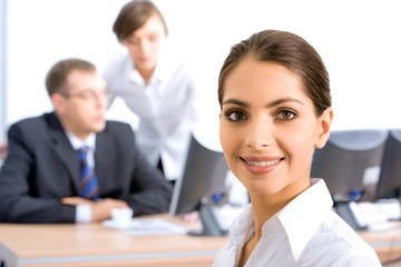 Successful woman on the background of  businesspeople