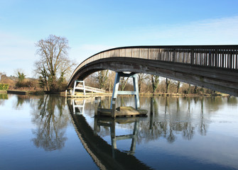 A contemporary Wooden Footbridge over the River Thames