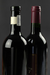 low-key image of dark wine bottles