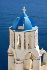A colorful blue dome in the Santorini cliff town of Oia.