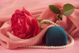 Red rose, beads and box for jeweller ornaments poster