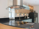 Modern luxury kitchen with integrated appliances poster