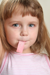 child in rose with chewing gum