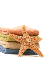 Stack of spa towels and starfish