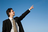 Businessman pointing forward with his hand poster