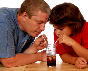 Father and Daughter Sharing Soda