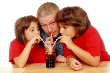 Father and Daughters Sharing Soda