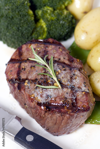A grilled top sirloin steak .. medium with broccoli