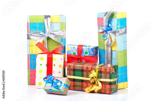 Assortment of gift boxes, reflected on white background