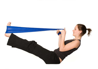 Woman is stretching her legs with a Resistance Band