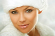 Portrait of beautiful woman wearing white fur hat