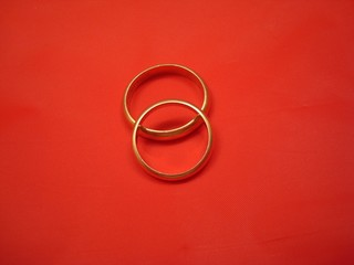 Wedding Rings On Red