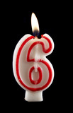 Burning number six candle with dripping wax. poster
