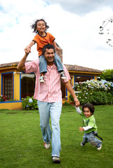 family lifestyle portrait of a dad with their two kids