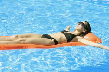 swimming on an inflatbale mattress