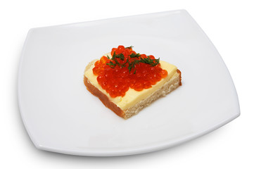Sandwich with red caviar on a white plate