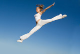 woman jumping, doing split leap poster