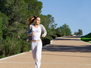 fit healthy woman jogging running or exercising