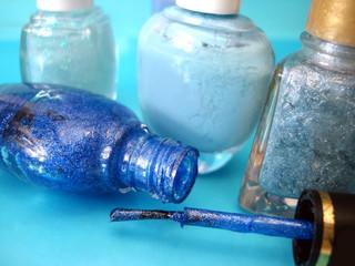 nail polish on blue background