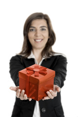 Beautiful bussiness woman holding a gift isolated on white