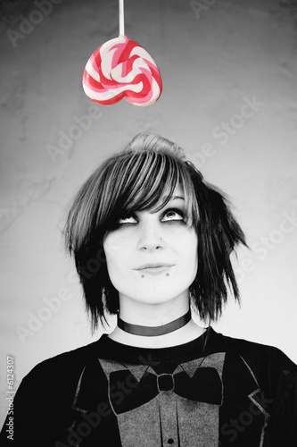 Alternative Girl Looking up at a Heart Lollipop