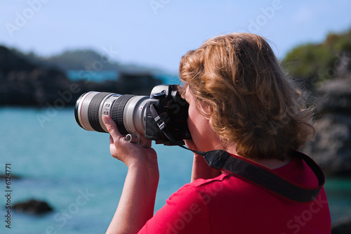 Photographer, Female, with Large White Lens