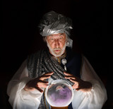 Swami gazing into a crystal ball poster