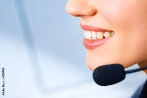 Image of mouth of consultant isolated on a blue background