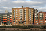 London, old warehouse on the Thames converted into apartments poster