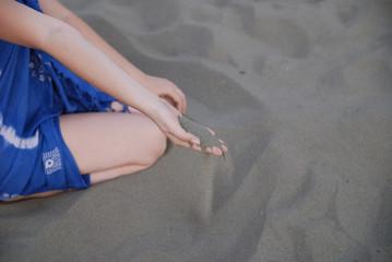 fine sand leaking through hands