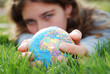 earth is being held by a little girl's hands(shows europe)
