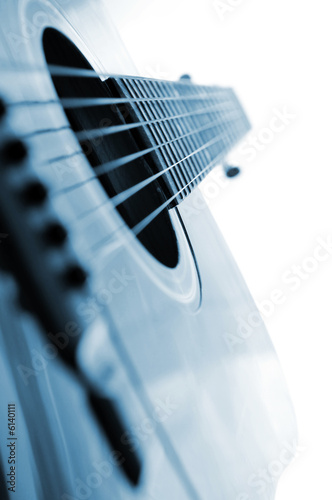 Acoustic guitar close up on white background