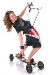Young attractive female  doing mountain board kite surfing.
