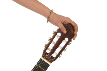 A thin finger is holdings a top of guitar
