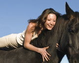 happy young woman and her stallion poster