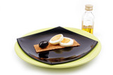 fiber egg black olive and olive oil on a black and green plate poster